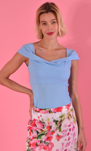 Top Nijinski light bleu, Glamorous, fitted, with plunging neckline, embellished with a drape crossed in front, very sixties.