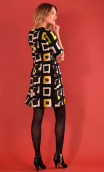 Robe Jess Printed Percussions, stretch dress, trapeze skirt, above the knee, 3/4 sleeve.